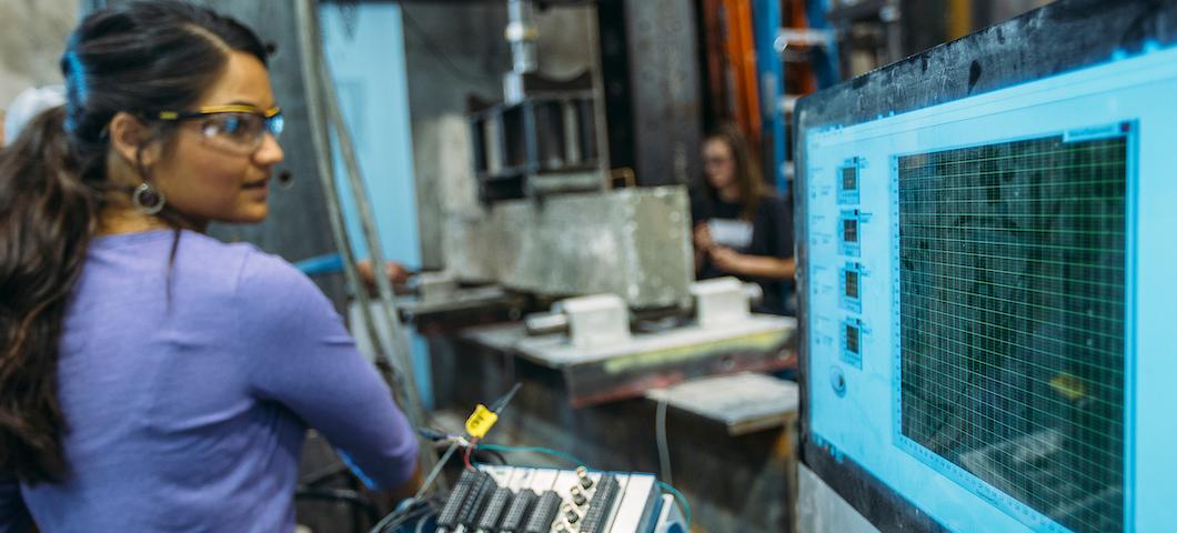 MSU student in concrete breaking laboratory