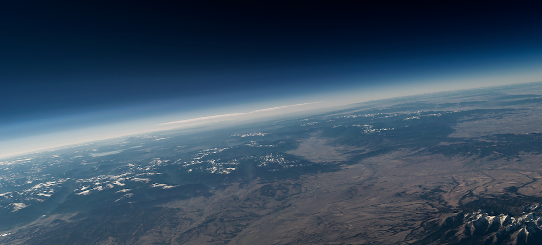 view from high-altitude balloon showing curvature of the Earth and the blackness of space