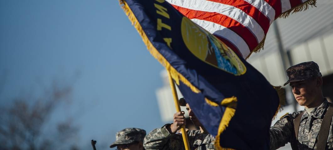 image of ROTC students waving US and Montana flags