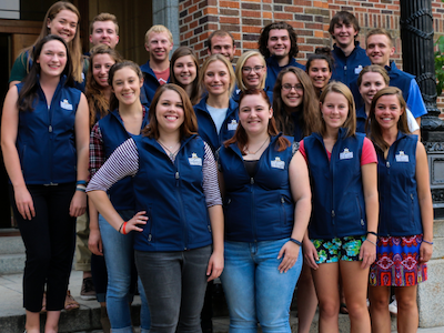 photo of several engineering ambassadors in matching blue vests standing on steps of Roberts Hall