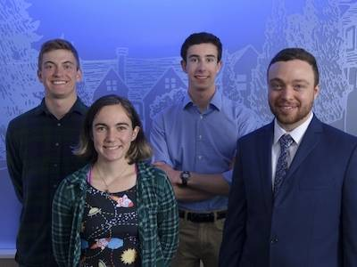 four students who won goldwater scholarships posing in front of blue background