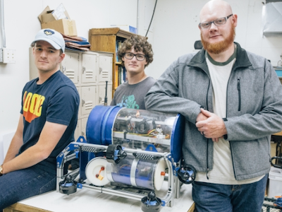 photo of three students standing by their robosub
