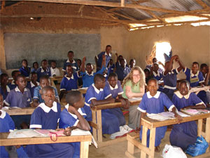 Kim Slack with students in Kenyan classroom