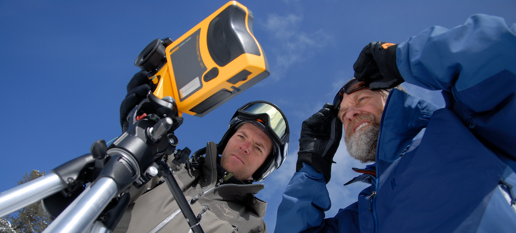 MSU researchers looking at device for snow science outdoors under blue sky