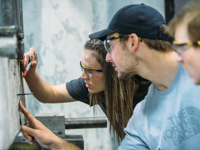 MSU students examining a concrete crack in the lab