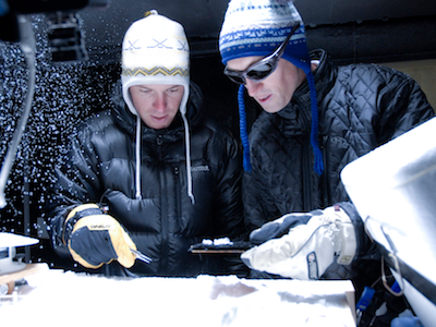Two MSU students in Subzero Facility examining snow sample